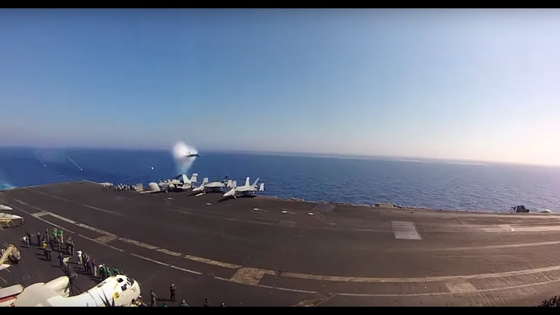 Going Supersonic F 18 Sonic Boom Past A US Navy Aircraft Carrier